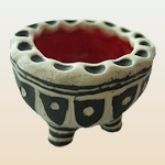 Small image of footed pinch pot by Anya Jackson.