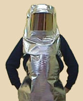 Aluminized safety knee-length apron and hood with gold face shield.